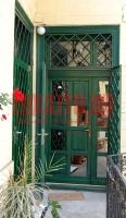 Reflexiós üveggel ellátott bejárati ajtó Budapest 15. kerület